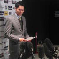 East coach Shuto Kawachi speaks with the media following the bj-league All-Star Game on Sunday. | ED ODEVEN