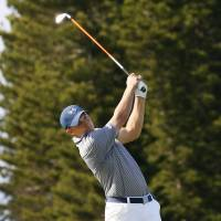 Jordan Spieth hits a shot from the fairway on the ninth hole during the second round of the Tournament of Champions on Friday in Kapalua, Hawaii. Spieth carded a 64 and leads by four strokes. | AP
