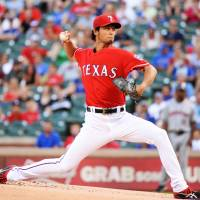 Texas Rangers star Yu Darvish is being investigated by Major League Baseball for a possible link to his brother's arrest by Osaka police last year for running a gambling ring. | KYODO