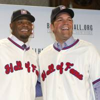 Ken Griffey Jr. (left) and Mike Piazza smile after a news conference announcing their election to baseball's Hall of Fame on Thursday. | AP