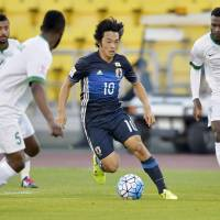 Japan's Shoya Nakajima takes on the Saudi Arabia defense during their game at the Under-23 Asian Championship in Doha on Tuesday. Japan won 2-1. | KYODO