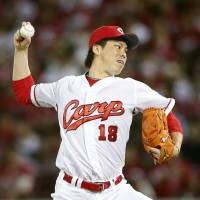 Carp ace Kenta Maeda could suit up for the Dodgers in MLB next season. | KYODO