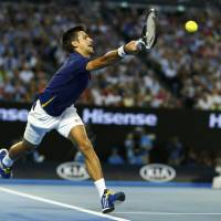Djokovic cruises past Federer, books spot in fifth straight Grand Slam final
