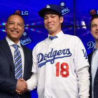 Pitcher Kenta Maeda poses with Los Angeles Dodgers manager Dave Roberts (left) and president of baseball operations Andrew Friedman after being introduced at a news conference on Thursday. | USA TODAY / REUTERS