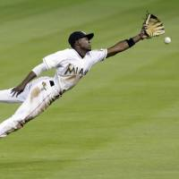 Miami Marlins second baseman Dee Gordon agreed to a five-year, $50 million contract extension with the team on Wednesday thereby avoiding arbitration. | AP