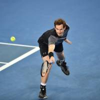 Andy Murray plays a backhand return against Joao Sousa on Saturday at the Australian Open. Murray recorded a 6-2, 3-6, 6-2, 6-2 win to advance to the fourth round.   AFP-JIJI