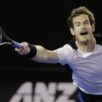 Andy Murray hits a return to Milos Raonic during their semifinal match at the Australian Open on Friday. | AP