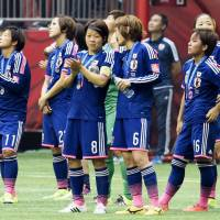 Nadeshiko Japan stand on the pitch after the Women's World Cup final on July 5, 2015, in Vancouver. | KYODO