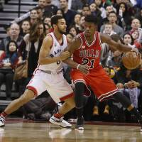 Raptors guard Cory Joseph (left) defends the Bulls' Jimmy Butler during the first half on Sunday in Toronto. Butler scored 42 points in Chicago's 115-113 win. | USA TODAY / REUTERS