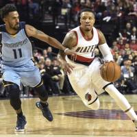 Portland's Damian Lillard drives to the basket on Memphis' Mike Conley in the first half on Monday night. | AP