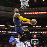 Cavaliers forward LeBron James goes up for a dunk during Cleveland's win over the Sixers on Sunday. | USA TODAY / REUTERS