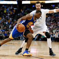 Nuggets withstand rally to hold off Warriors