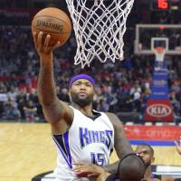 Sacramento's DeMarcus Cousins goes to the basket during the Kings' 110-103 win over the Clippers on Saturday. | AP