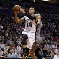 San Antonio's Danny Green goes up for a layup against Phoenix's Kyle Anderson in the third quarter on Thursday night. The Spurs routed the Suns 117-89. | AP