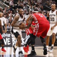 San Antonio's Kawhi Leonard is fouled by Houston's Josh Smith during the Spurs' 130-99 win on Wednesday. | USA TODAY / REUTERS