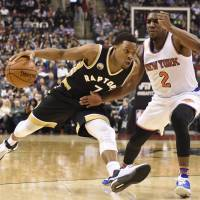 Toronto's Kyle Lowry drives on New York's Langston Galloway in the first half on Thursday night. The Raptors won 103-93. | AP