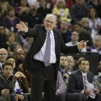 Kings coach George Karl guides his team during the second half against the Suns on Saturday in Sacramento, California. The Kings beat Phoenix 142-119, giving Karl his 1,155th coaching victory, which tied him with  Phil Jackson for fifth on the NBA wins list. | AP