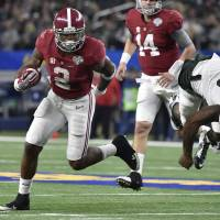 Alabama running back Derrick Henry (2) runs past Michigan State defensive end Shilique Calhoun (89) on his way to the end zone on Thursday in Arlington, Texas. | USA TODAY / REUTERS