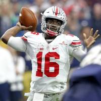 Ohio State's J.T. Barrett throws a pass against Notre Dame during the second half of the Fiesta Bowl on Friday in Glendale, Arizona.   AP
