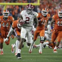 Alabama's Derrick Henry runs for a touchdown in the first half of the NCAA College Football Playoff championship game against Clemson on Monday night in Glendale, Arizona. The Crimson Tide beat the Tigers 45-40. | AP