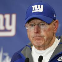 New York Giants coach Tom Coughlin answers questions at a news conference after his team lost to the Philadelphia Eagles on Sunday. Coughlin resigned on Monday after 12 seasons at the helm. | AP