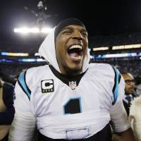 Carolina quarterback Cam Newton celebrates after the Panthers' win over the Cardinals in the NFC title game on Sunday. | AP