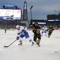 Boston goalie Tuukka Rask (40) makes a save as teammate Adam McQuaid (64) defends against Montreal's Brendan Gallagher in the Winter Classic at Gillette Stadium in Foxborough, Massachusetts, on New Year's Day. | AP