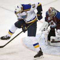 Colorado goalie Semyon Varlamov makes a glove save of shot redirected between his legs by St. Louis' David Backes in the first period on Wednesday night.   AP
