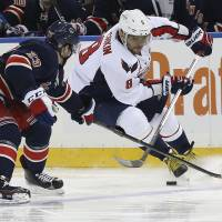 Washington's Alex Ovechkin moves the puck during the Capitals' 4-3 win over the Rangers on Saturday. | AP