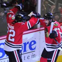 The Blackhawks' Patrick Kane (right) celebrates with teammate Artemi Panarin after scoring on Sunday. | USA TODAY / REUTERS