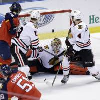 Florida's Brian Campbell (51) scores over Chicago goalie Scott Darling in the first period on Friday night. The Panthers downed the Blackhawks 4-0. | AP