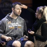Montreal's John Scott waits for a television interview to begin as a makeup artist touches him up during the NHL's All-Star Game media day on Friday in Nashville, Tennessee. | AP
