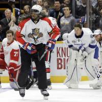 The Canadiens' P.K. Subban, wearing a wig and a Jaromir Jagr Panthers jersey, skates during the skills competition on Saturday.   AP