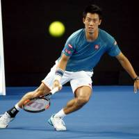 Kei Nishikori watches a shot during a practice session at Melbourne Park on Friday ahead of the Australian Open, which starts Monday. | REUTERS