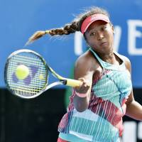 Naomi Osaka plays a shot during her match against Donna Vekic in the first round of the Australian Open on Tuesday. | KYODO