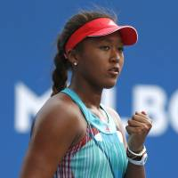 Naomi Osaka reacts after a point during her match on Tuesday in Melbourne, Australia. Osaka will face 18th-seeded Elina Svitolina of Ukraine in the second round of the Australian Open. | AP