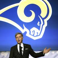 Stan Kroenke, owner of the Rams, speaks during a news conference at The Forum in Inglewood, California, on Friday about the team's move back to Los Angeles. | AP