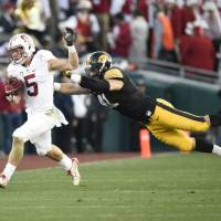 Stanford's Christian McCaffrey eludes a tackle by Iowa's Bo Bower in the third quarter of the Rose Bowl on New Year's Day. | USA TODAY / REUTERS