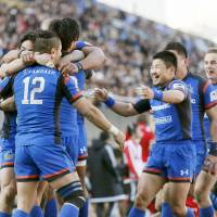 Wild Knights players celebrate during their victory over the Steelers on Saturday at Prince Chichibu Memorial Rugby Ground.   KYODO