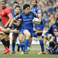 Panasonic's Kentaro Kodama goes on the attack during the Wild Knights' 49-15 win over Teikyo University in the All-Japan Championship on Sunday. | KYODO