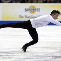 Max Aaron competes in the short program at the U.S. Figure Skating Championships on Friday in St. Paul, Minnesota. Aaron finished in first place. Aaron leads heading into Sunday's free skate. | AP