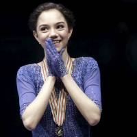 Russia's Evgenia Medvedeva smiles following her victory at the European Championships in Bratislava on Friday night. Medvedeva won the title with a total score of  215.45 points. | REUTERS