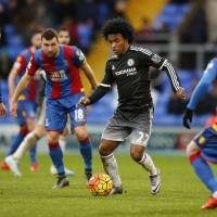 Chelsea's Willian controls the ball in a crowd on Sunday at Selhurst Park in London. Chelsea beat Crystal Palace 3-0. | REUTERS