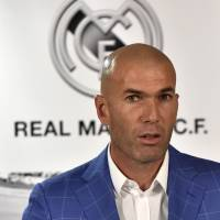Zinedine Zidane is introduced as the new manager of Real Madrid at a news conference in the Spanish capital on Monday. | AFP-JIJI