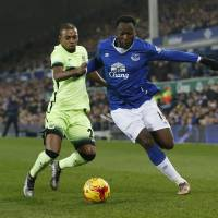 Everton's Romelu Lukaku (right) vies for the ball with Manchester City's Fernandinho in League Cup action on Wednesday night. Everton won 2-1. | REUTERS