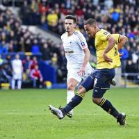 Kemar Roofe scores Oxford's third goal against Swansea during their F.A. Cup match on Sunday in Oxford, England. | REUTERS