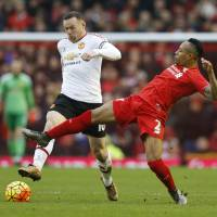 Manchester United striker Wayne Rooney (left) competes against Liverpool's Nathaniel Clyne on Sunday at Anfield in Liverpool, England. Rooney scored the only goal of the match.   REUTERS