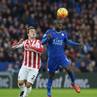 Leicester's Ngolo Kante (right) heads the ball in front of Stoke's Xherdan Shaqiri during their game on Saturday.   REUTERS