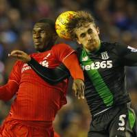 Liverpool's Christian Benteke (left) and Stoke's Marc Muniesa contest at header at Anfield on Tuesday night. | REUTERS
