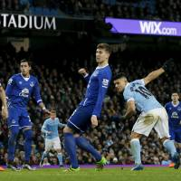 Manchester City's Sergio Aguero (far right) heads home the winning goal in Wednesday's League Cup semifinal second leg against Everton. | REUTERS